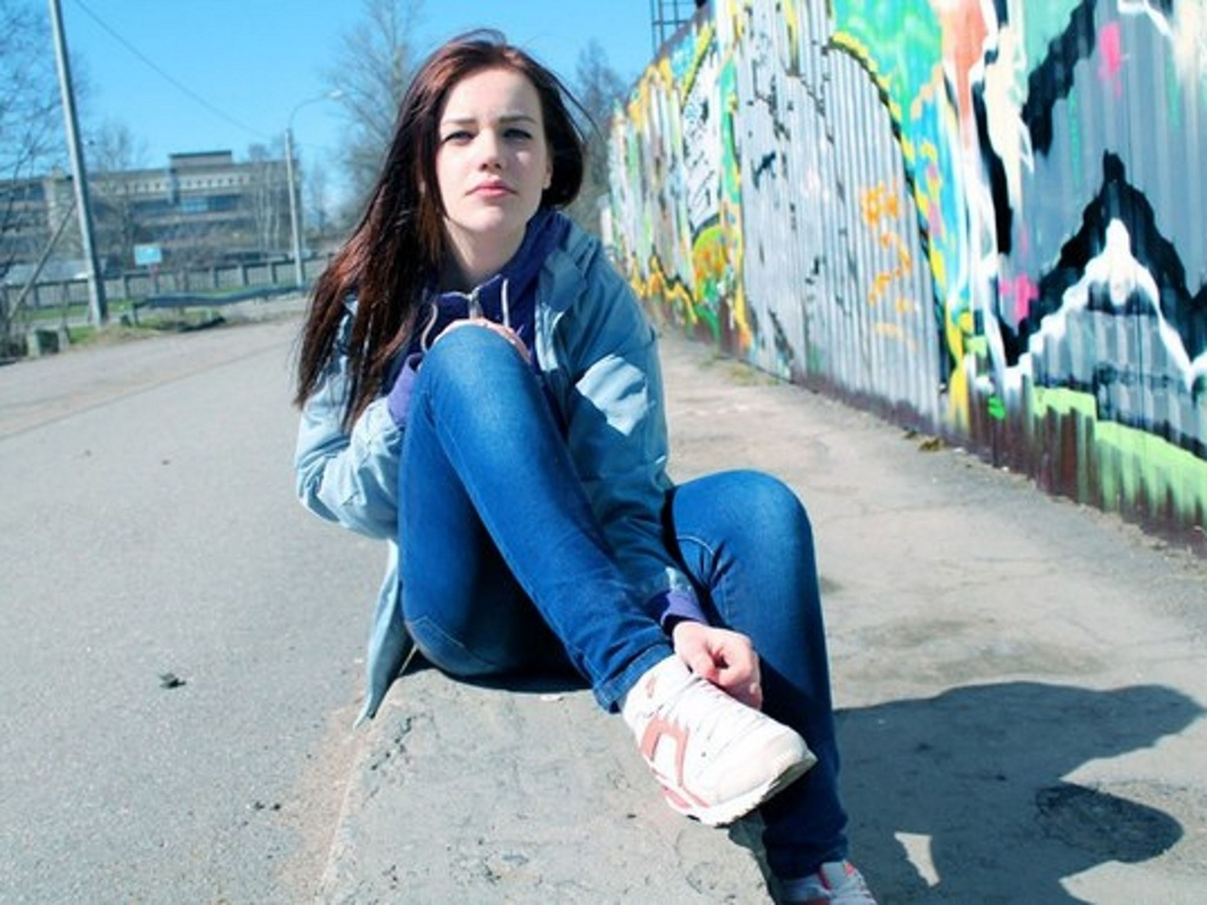 young adult, lifestyles, person, looking at camera, casual clothing, portrait, young women, front view, leisure activity, smiling, standing, long hair, happiness, full length, three quarter length, graffiti