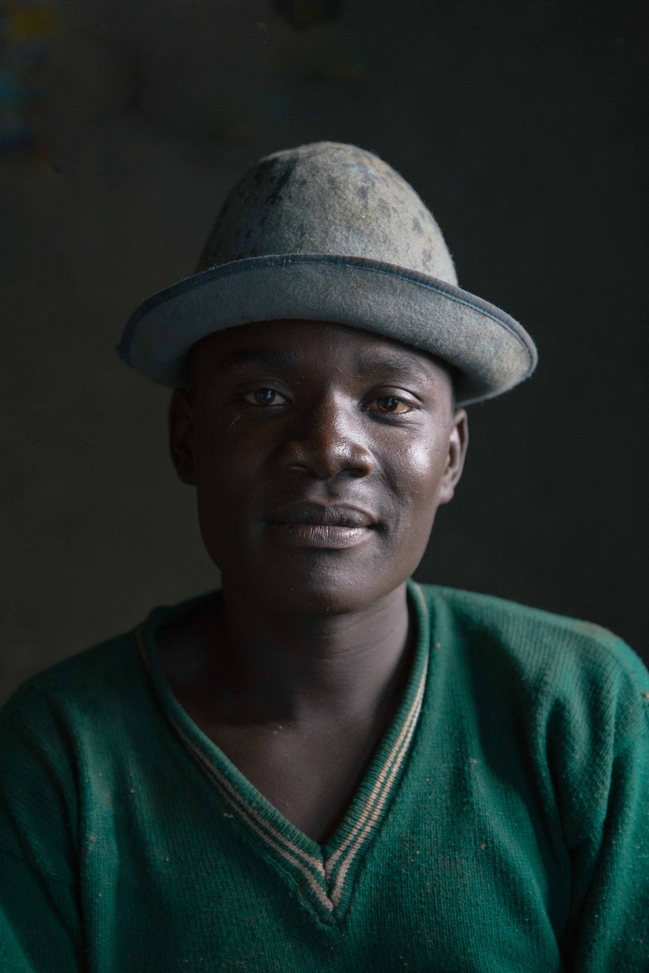 The Portraitist - 2017 EyeEm Awards I met Cyriaque whilst in Rwanda. With a storm brewing and pregnant with precipitation, the clouds graced Rwandan soil with rain . Whilst fumbling in my backpack for my coat, Cyriaque saw me getting wet and invited me into the courtyard of a house on the roadside. His grey felt hat caught my attention as the rain welled up and dripped from the brim. Once I was invited inside to shelter a single window cast a beautiful soft light on any shape or form it touched. Cyriaque and his grey hat was once such form. The Portraitist - 2017 EyeEm Awards