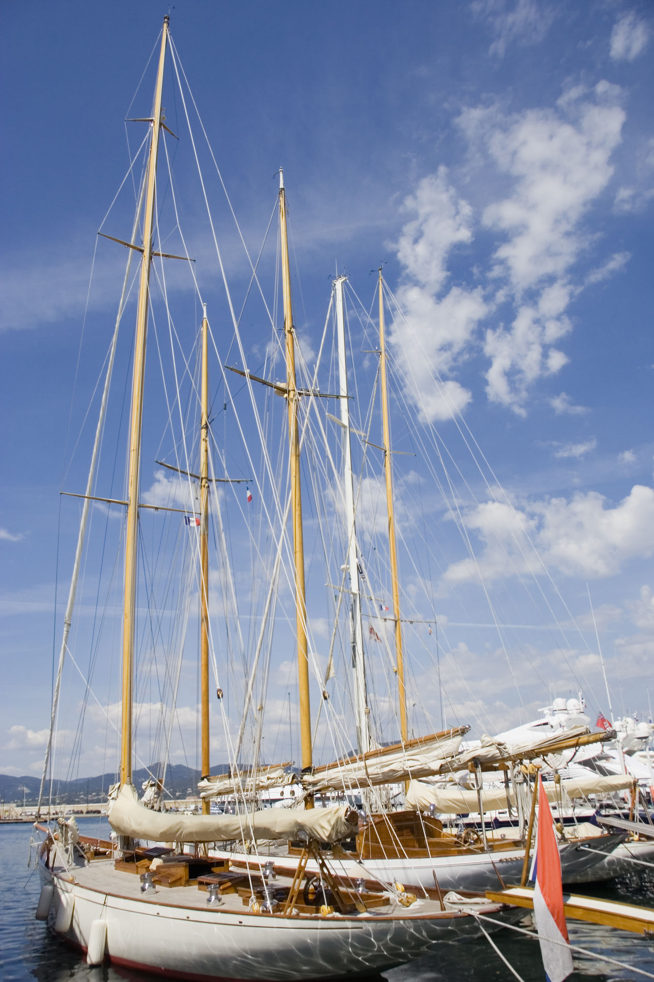sailing yachts in the port of saint-tropez - french riviera, mediterranean sea Cruise Côte D'Azur Dockside France Harbor In A Row Mast Mediterranean Sea Mode Of Transport Moored Nautical Vessel No People Port Rigging Sailboat Sailing Sailing Boat Sailing Ship Sailing Yacht Saint Tropez Saint-Tropez Sea Transportation Yacht Yachting