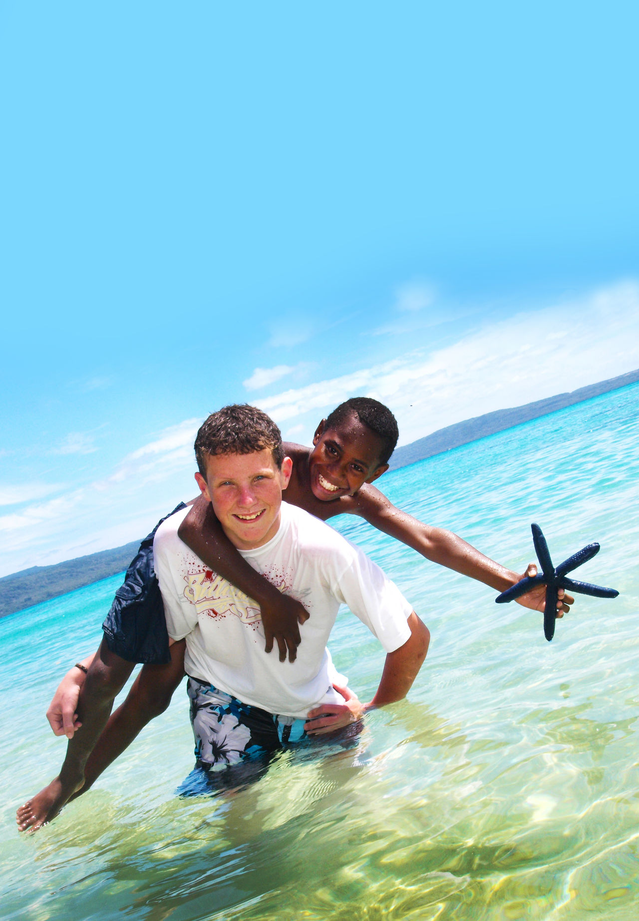 The Blue Star Fish Port Vila Vanuatu Beach Fun Beach Life Blue Blue Starfish Bonding Casual Clothing Childhood Cloud - Sky Day Enjoyment Family Friendship Fun Holding Innocence Leisure Activity Lifestyles Non-urban Scene Sea Sibling Sky Togetherness Vacations Vanuatu Water