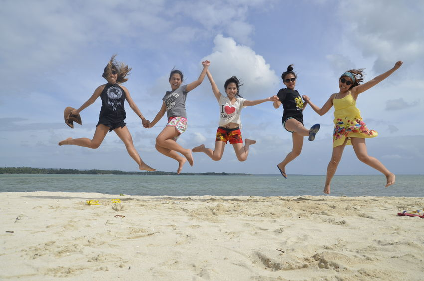 Arms Raised Beach Cheerful Enjoyment Friends Friendship Fun Happiness Happy Happy People Jumping Leisure Activity Lifestyles Live For The Story Mid-air Outdoors Sea Sky Smile Summer Travel Travel Destinations Vacations Vacations Vitality Sommergefühle Connected By Travel