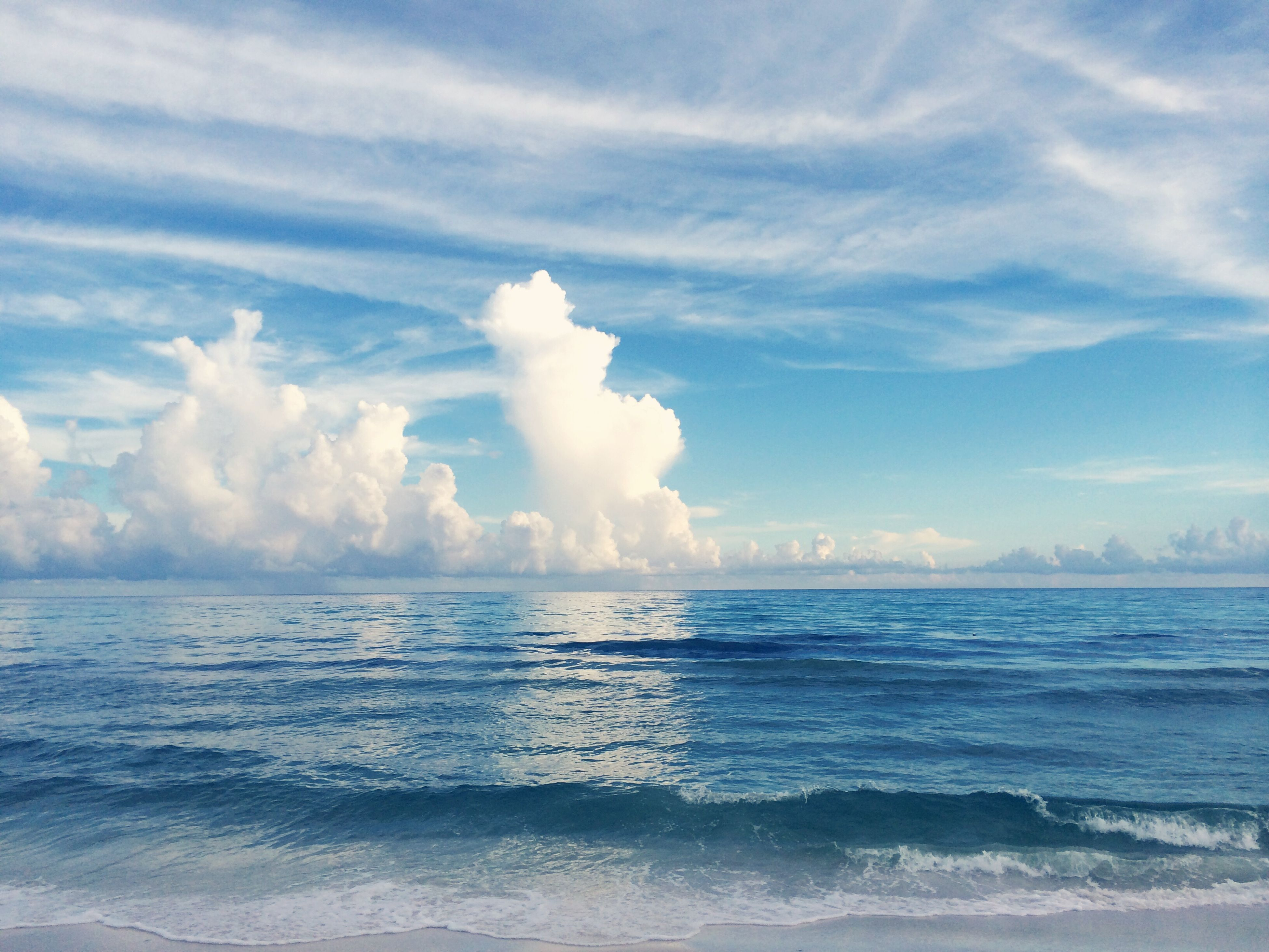 sea, water, horizon over water, sky, scenics, beauty in nature, tranquil scene, tranquility, cloud - sky, beach, nature, wave, cloudy, idyllic, cloud, shore, waterfront, seascape, blue, surf
