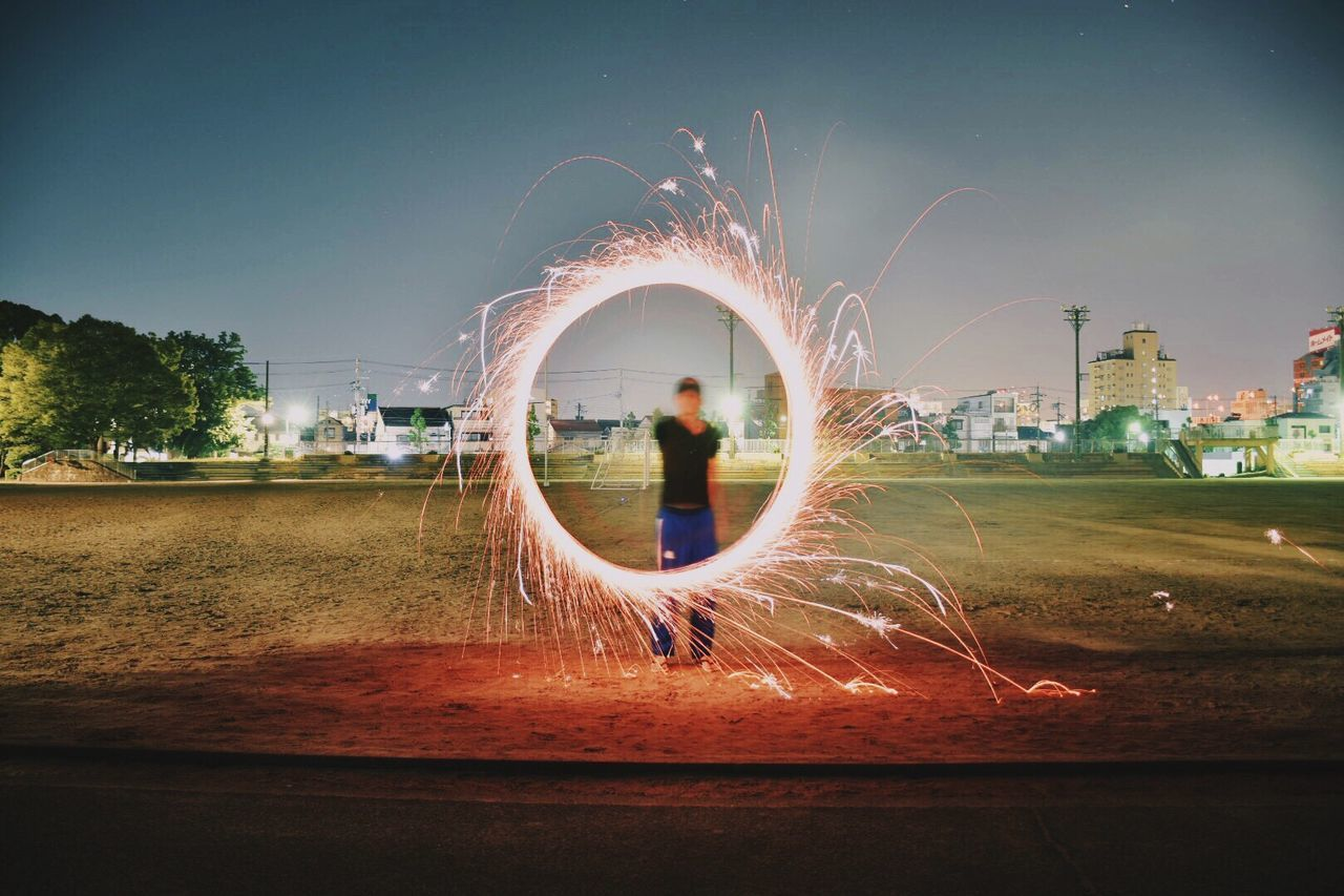 Beautiful stock photos of feuerwerk, motion, spinning, one person, outdoors