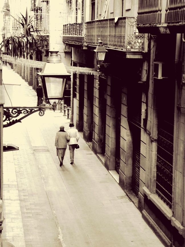 Having a stroll with someone who loves you, Enjoy The Little Things Relaxing Retro Style Timeless Family Walks Seize The Day City Life Nostalgic  Seize The Moment Black And White Sepia at Barcelona SPAIN