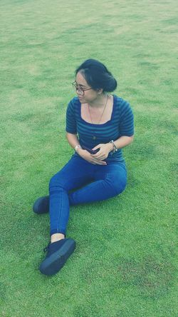 Full Length Sitting Casual Clothing Teenager Grass One Person Outdoors Day Nature