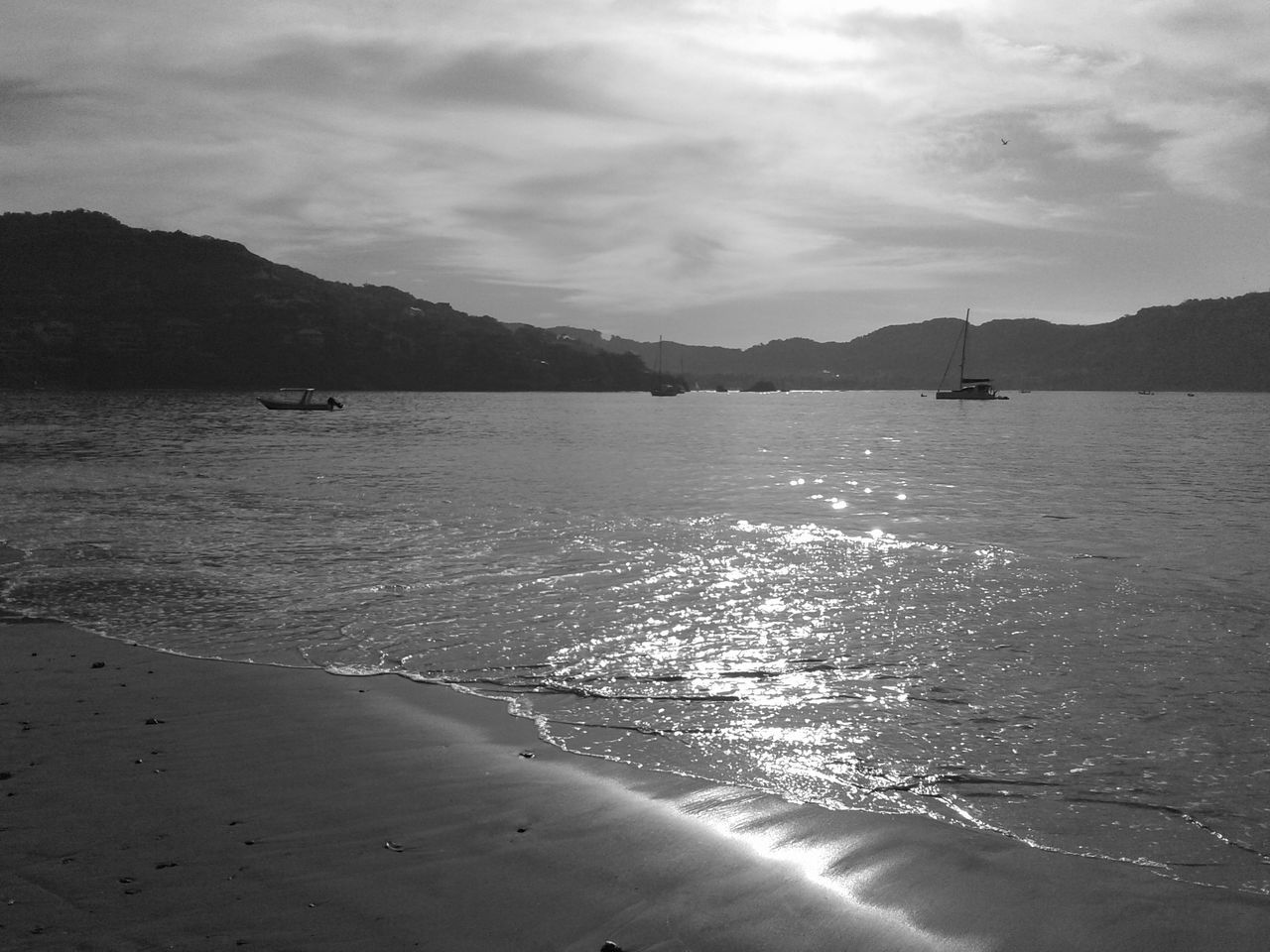 water, sea, mountain, sky, nature, scenics, beauty in nature, no people, tranquility, outdoors, cloud - sky, sunlight, beach, day