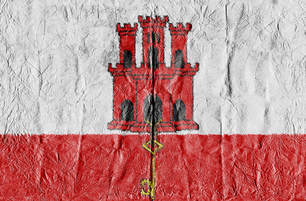 Gibraltar Flag on a paper in close-up Background Close-up Concept Country Flag Eu Europe Flag Freedom Gibraltar Gibraltar Flag Growth Isolated Land National Flag National Land Paper Pattern State Symbol Textured  Travel