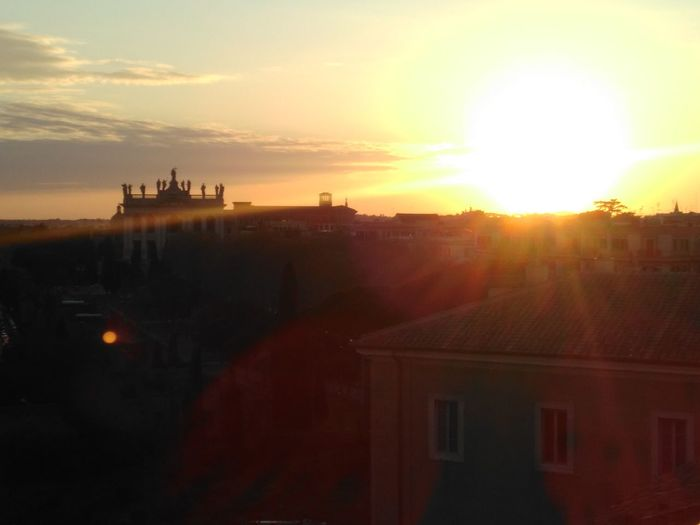Sunset over Rome, San Giovanni in Laterano (unfiltered) Sunset Architecture Building Exterior Sun Built Structure Red Travel Destinations No People Sunlight Outdoors Sky City Beauty In Nature Nature Day Rome Laterano Evening Sun Evening Romantic❤ Romantic Sky First Eyeem Photo