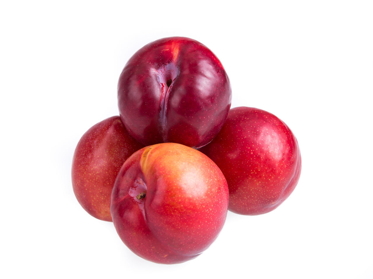 Close-Up Of Fresh Plums Against White Background