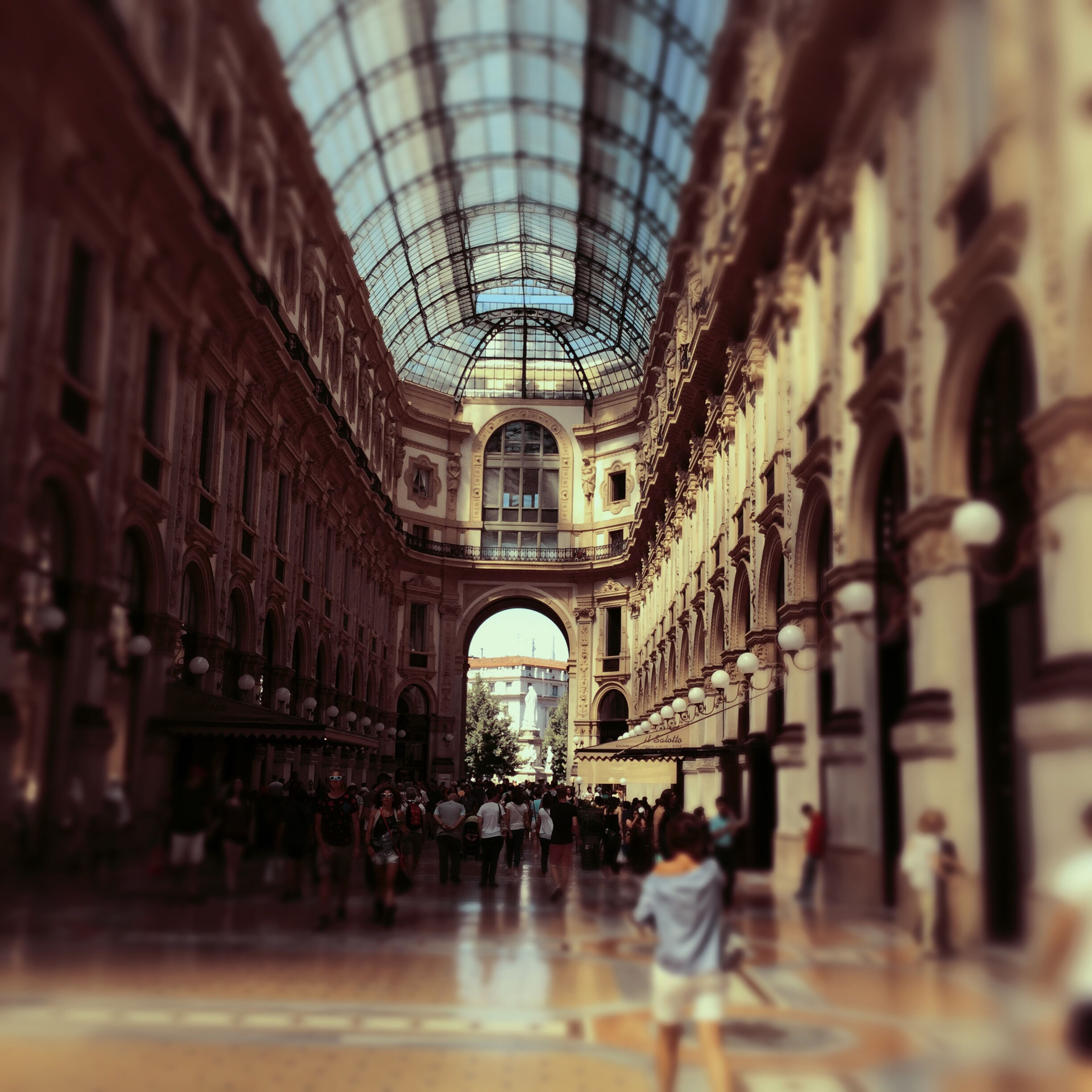 architecture, arch, built structure, walking, travel destinations, selective focus, city, building exterior, shopping mall, culture, day, city life, tourism, history, famous place, arcade