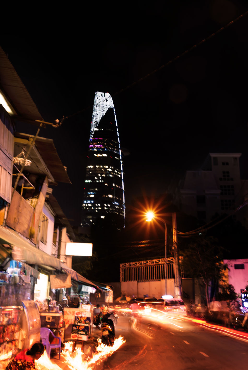 Architecture Bitexco Bitexcofinancialtower Built Structure City City Life City Street Contrast Illuminated Modern Night No People Opposite Outdoors Sky Streetphotography Travel Destinations Vietnam