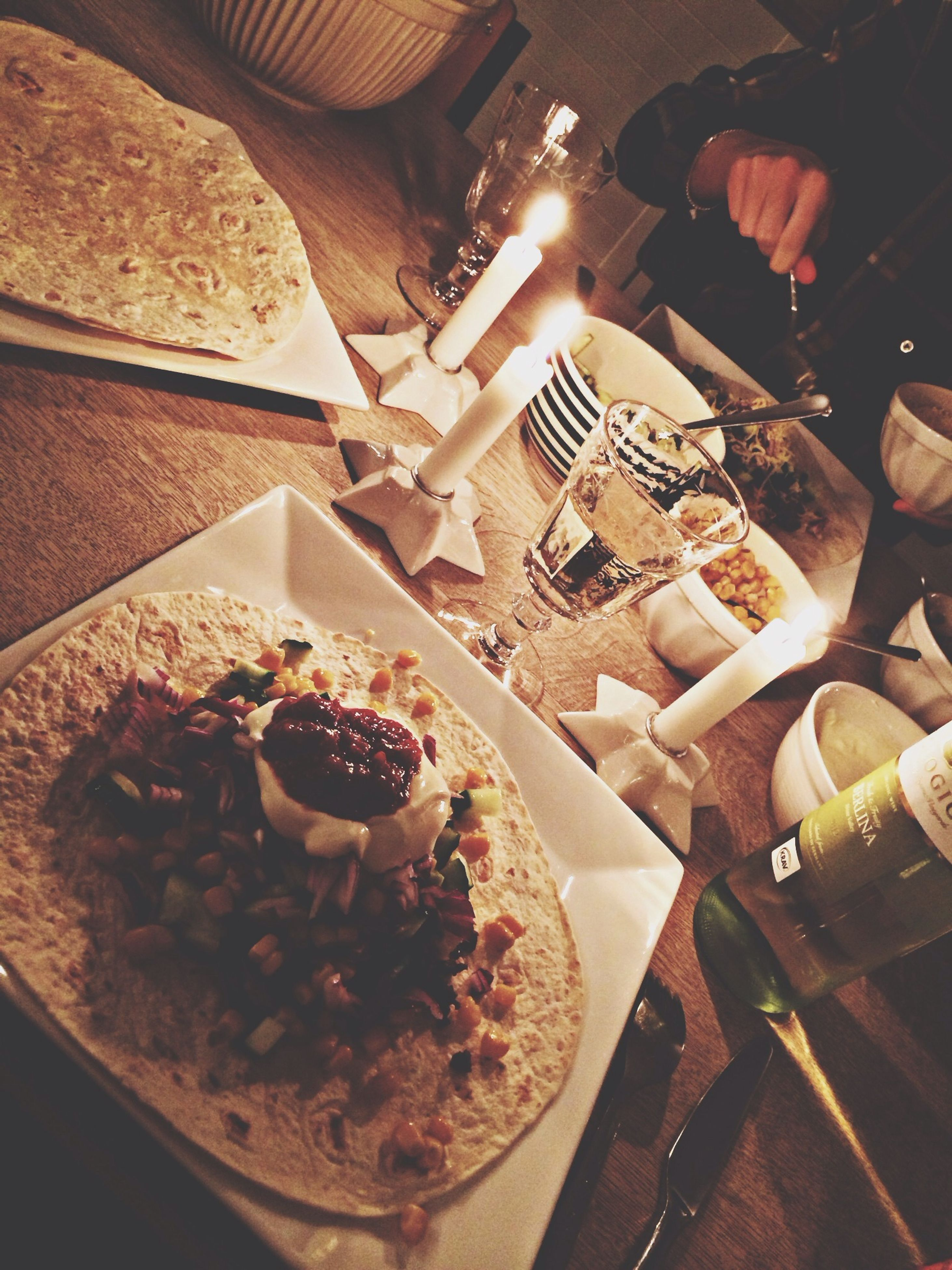 food and drink, food, indoors, freshness, lifestyles, table, high angle view, men, person, leisure activity, ready-to-eat, indulgence, holding, sweet food, restaurant, unrecognizable person