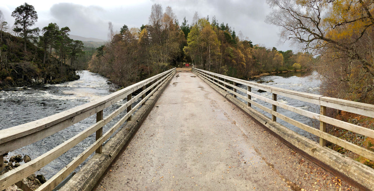 Glen Affric Loch Affric Scotland Beauty In Nature Bridge - Man Made Structure Cloud - Sky Cold Temperature Day Footbridge Forest Highlands Highlands Of Scotland Mountain Nature No People Outdoors Railing Scenics Sky Snow The Way Forward Tree Winter