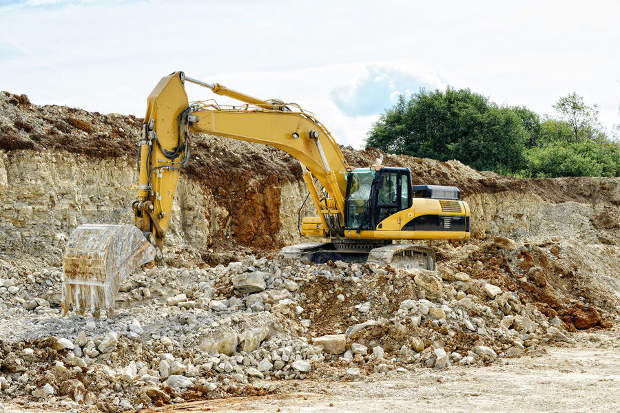 Earthmover in limestone quarry (Germany), sedimentary rock. Bagger Earth Mover Earth Moving Earthmover Franconia Franken Land Vehicle Limestone Mine Mining No People Open Pit Mine Open Pit Mining Outdoors Quarry Sky Steinbruch Transportation
