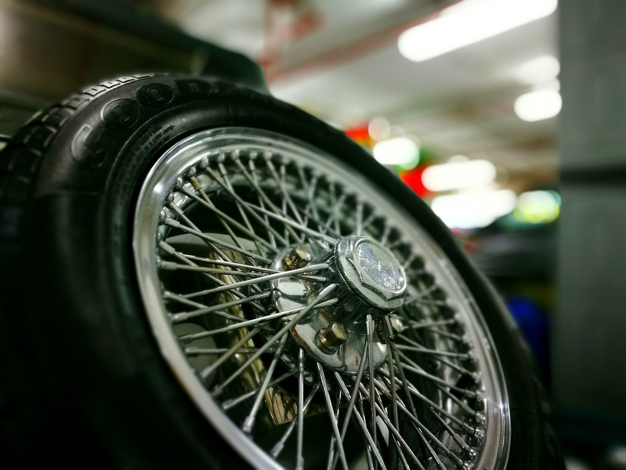 transportation, mode of transport, land vehicle, wheel, close-up, metal, no people, focus on foreground, spoke, vehicle part, car, indoors, gear, day, tire, gauge, speedometer