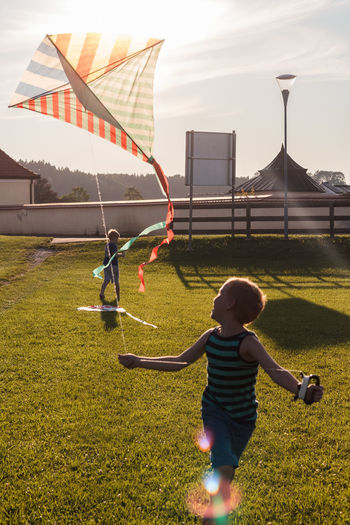 Dragon Freedom Fun Architecture Boys Casual Clothing Childhood Day Full Length Grass Leisure Activity Lifestyles Nature Outdoors Playing Real People Sky Standing To Fly A Kite To Glide To Hang Out The Week On EyeEm