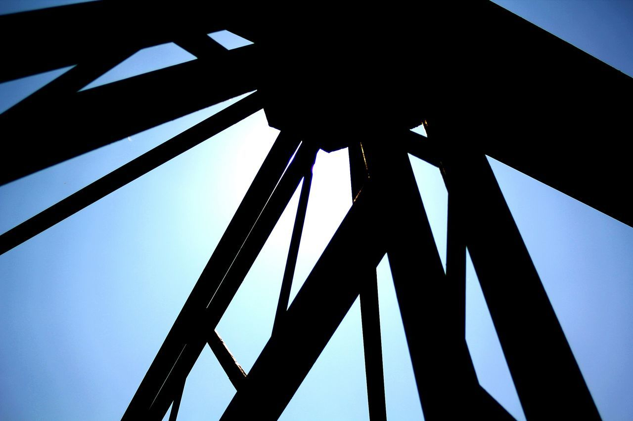 low angle view, built structure, architecture, day, communication, silhouette, clear sky, no people, blue, sky, outdoors, girder, close-up