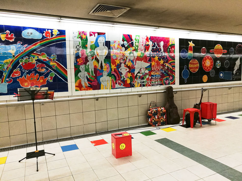 Colors abound, Music aloud, But where are they? Time to send in the clowns .... Multi Colored No People Indoors  Underground Station  Underground Passage Underground Walkway Underground Murals Muralsart Buskers Musical Instruments Performance