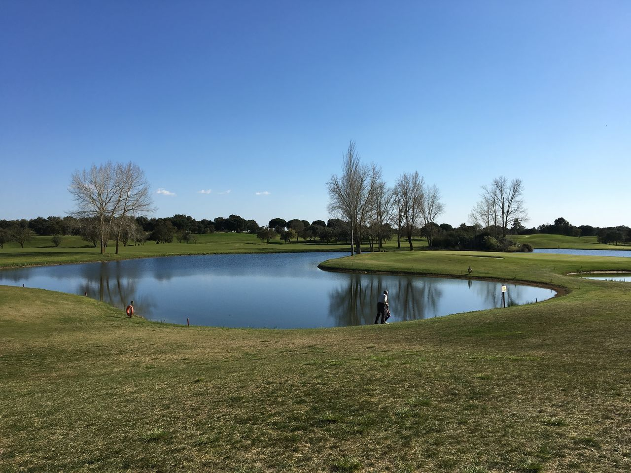 Beauty In Nature Blue Clear Sky Day Golf Golf Club Golf Course Golfer Grass Green - Golf Course Lake Nature No People Outdoors Scenics Sky Tranquil Scene Tranquility Tree Water