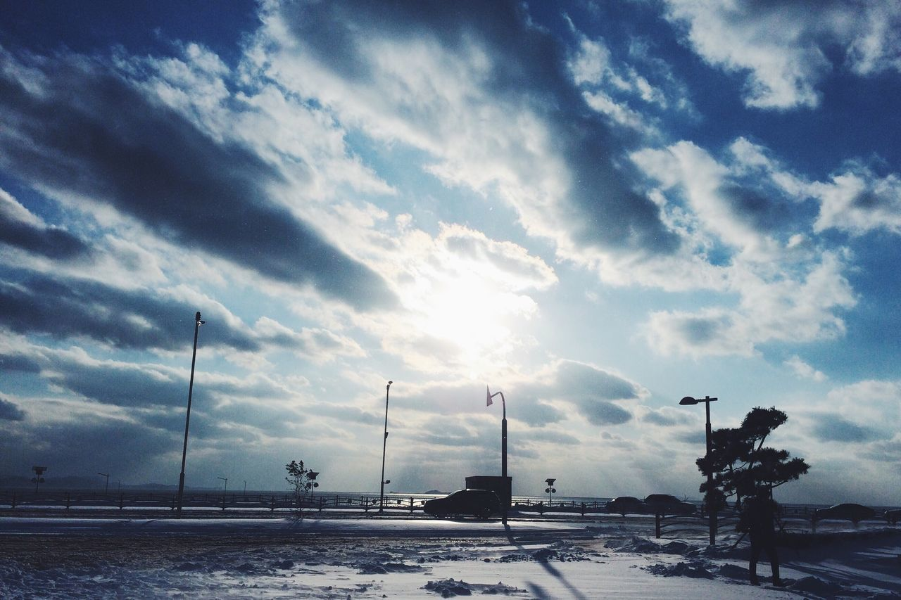 Soaking Up The Sun Taking Photos Clouds And Sky Silhouette Winter Snow