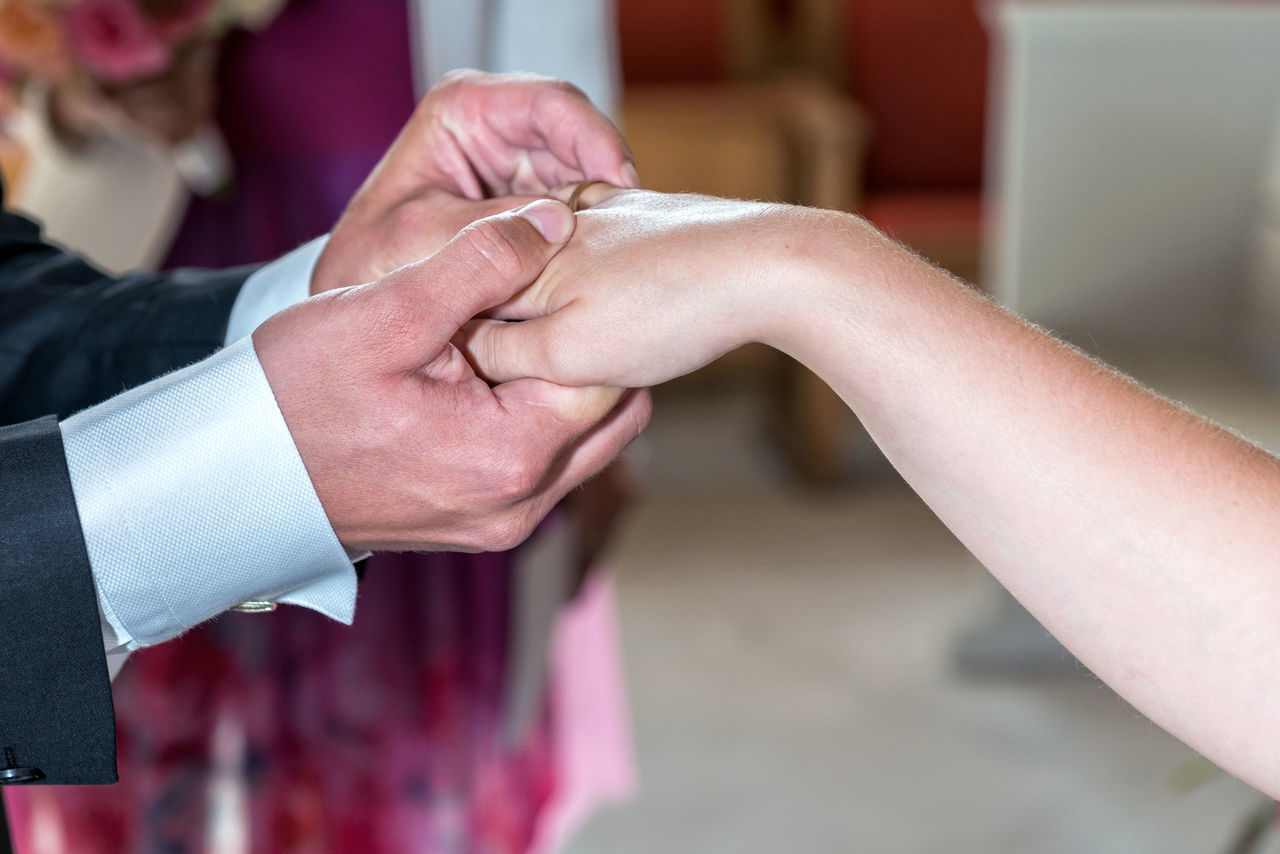 human hand, two people, real people, wedding, ceremony, focus on foreground, human body part, wedding ceremony, close-up, religion, holding, bride, life events, bridegroom, togetherness, men, groom, indoors, day