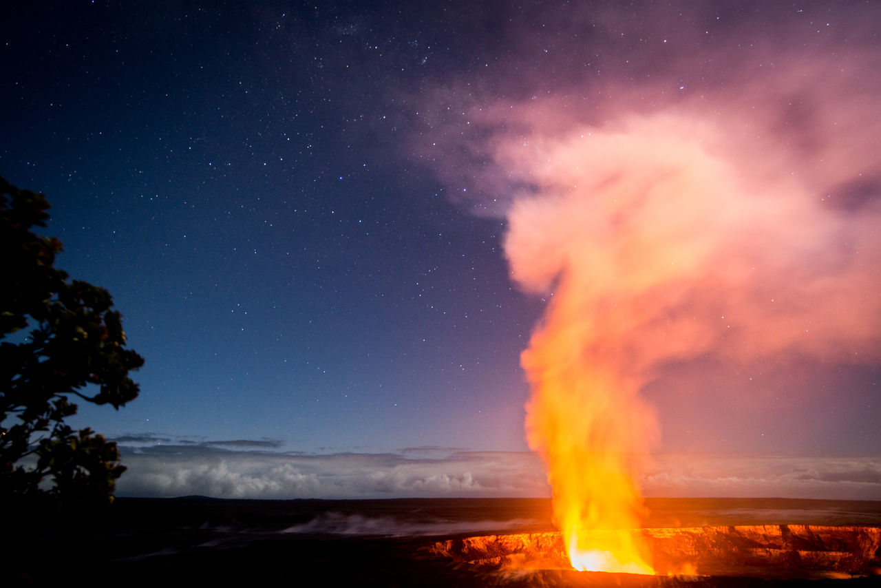 ©Amy Boyle Photography Beauty In Nature Burning Environment Erupting Fire - Natural Phenomenon Flame Glowing Hawaii Heat - Temperature Landscape Majestic Night Scenics Silhouette Sky Star - Space Star Field Tourism Tranquil Scene Travel Destinations Tree Volcanic Landscape Volcano Volcano Crater Volcano National Park