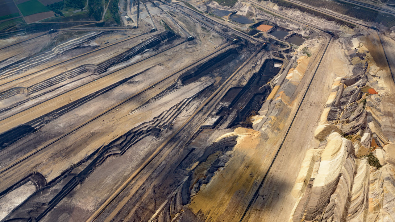 Bird's eye view of the Etzweiler mine. This hole in the earth, is as big a small city. A Bird's Eye View Abstract Colors Colourful Colours Earth Etzweiler EyeEm Best Shots From Above  Lines Mine No One No People Open Mine Open-cast Mining Open-cut Mining Open-pit Mining Polution Flying High