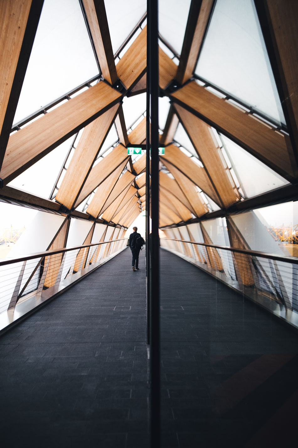 Canary vibes. Architecture Architecture Built Structure Check This Out City City City Life Day Exploring EyeEm Best Shots Full Length Geometry LINE London Modern One Person People Real People Reflection Reflections Streetphotography Taking Photos The Way Forward Triangle Walking