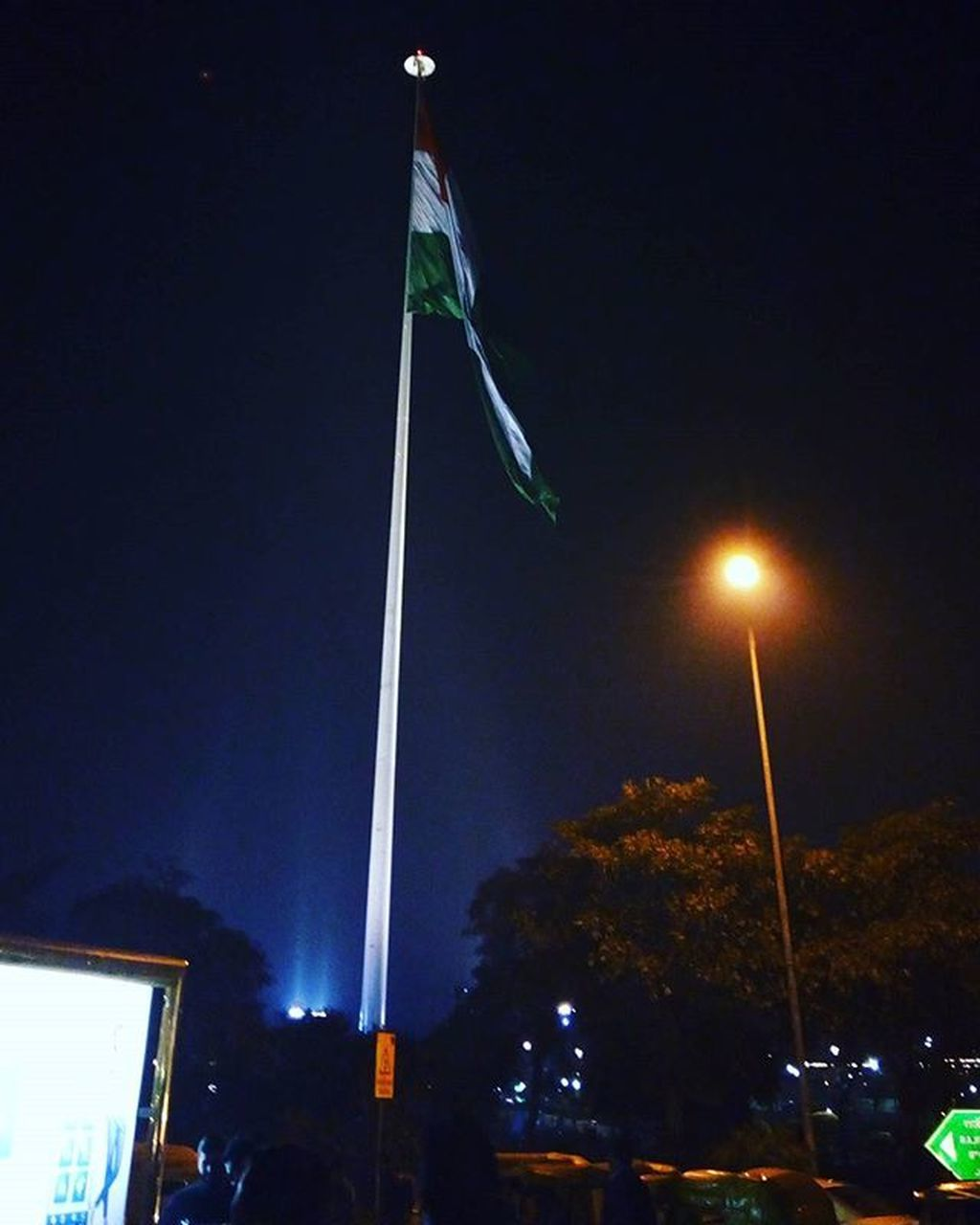 flag, night, illuminated, patriotism, low angle view, street light, architecture, outdoors, built structure, no people, building exterior, city, sky