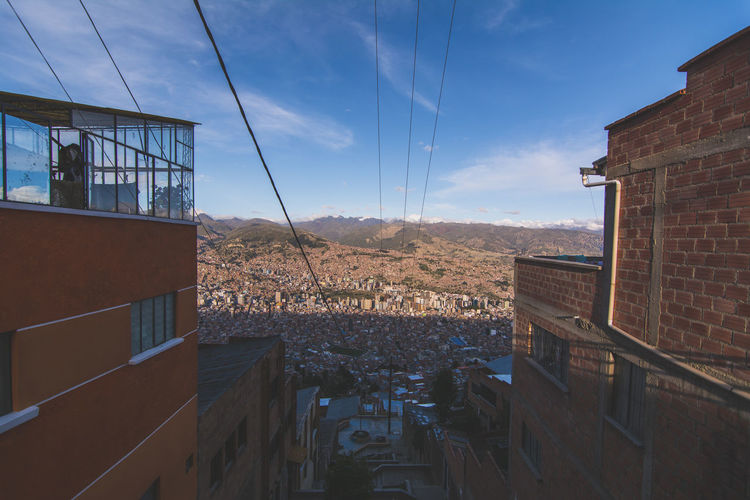 At the top of the Mi Teliferico cable car in La Paz, El Alto - Bolivia Architecture Blue Building Exterior Built Structure City City Life Cloud Cloud - Sky Day Horizon Over Land Modern No People Office Building Power Line  Rooftop Sky Tranquility