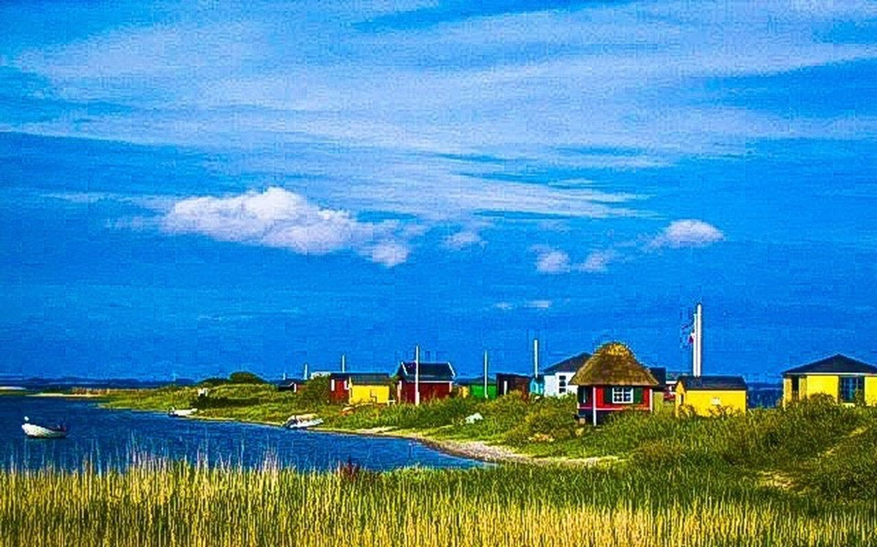 built structure, house, building exterior, blue, grass, no people, outdoors, architecture, beach, landscape, day, sea, nature, sky