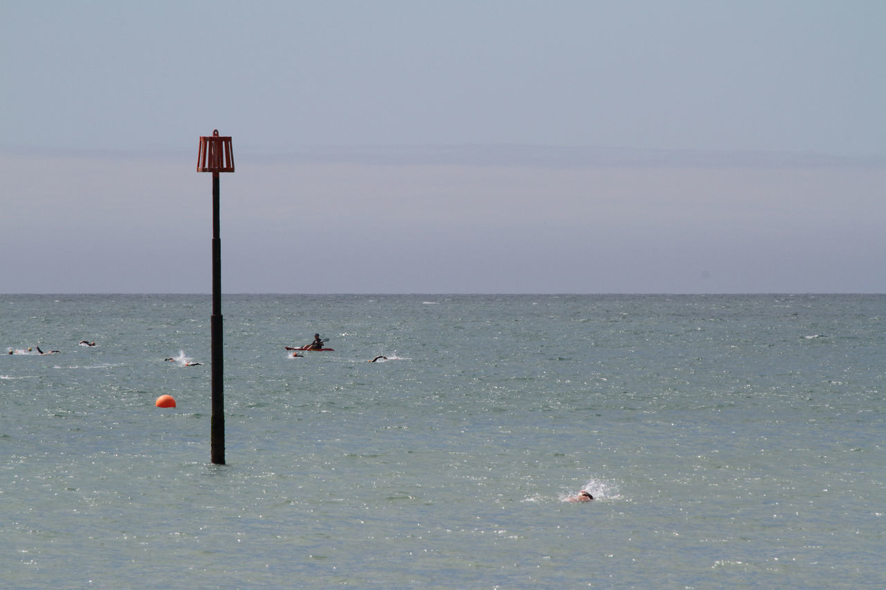 Beach Buoy Competition Day Eastbourne England Horizon Over Water Outdoors Paddleboarding Sea Sky Swimmers Swimmers In The Sea Swimming The Channel United Kingdom Water