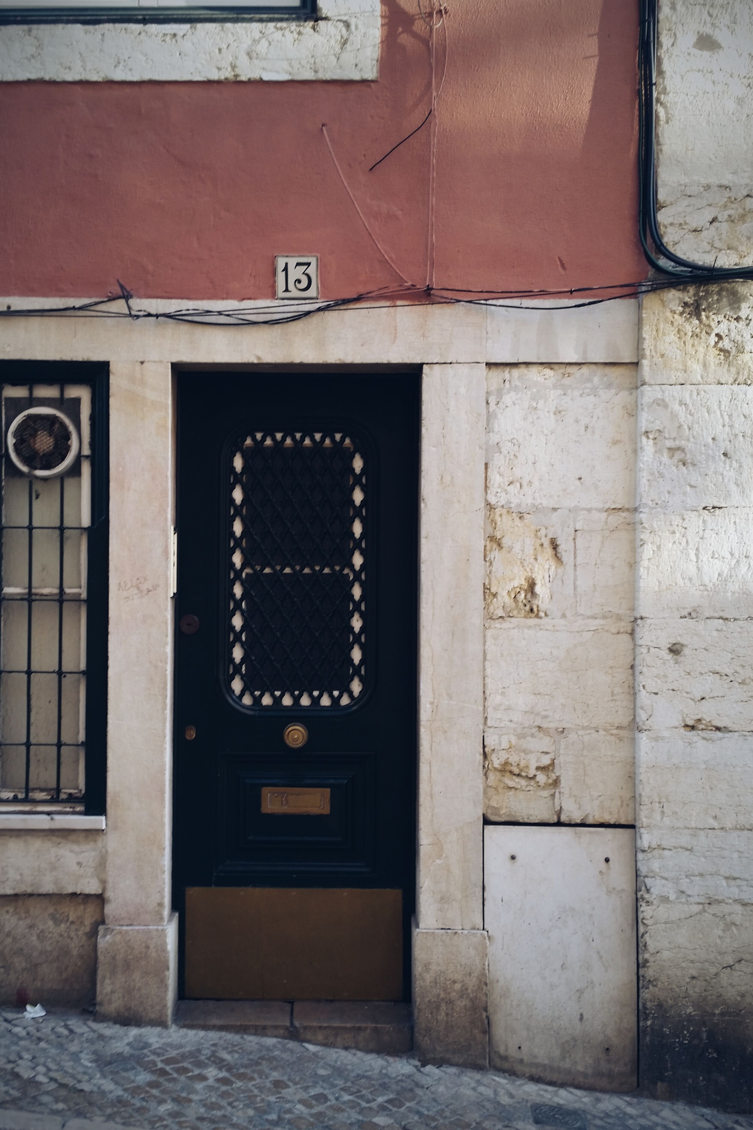 architecture, built structure, building exterior, door, closed, entrance, wall - building feature, text, communication, window, house, brick wall, old, wall, building, day, safety, no people, outdoors, western script