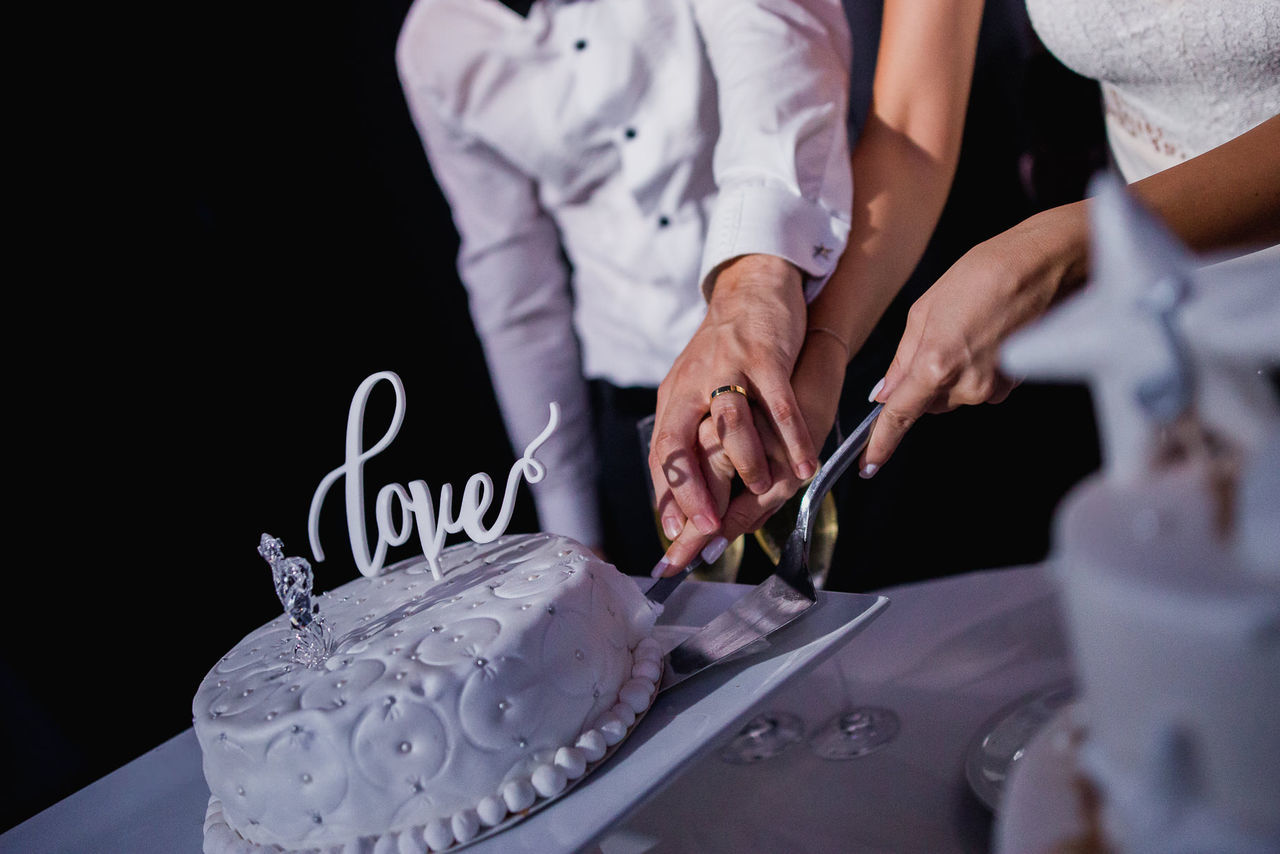 Wedding Cake Adult Adults Only Cake Celebration Event Close-up Day Human Body Part Human Hand Indoors  Love People Senior Adult Togetherness Uniform Wedding Women