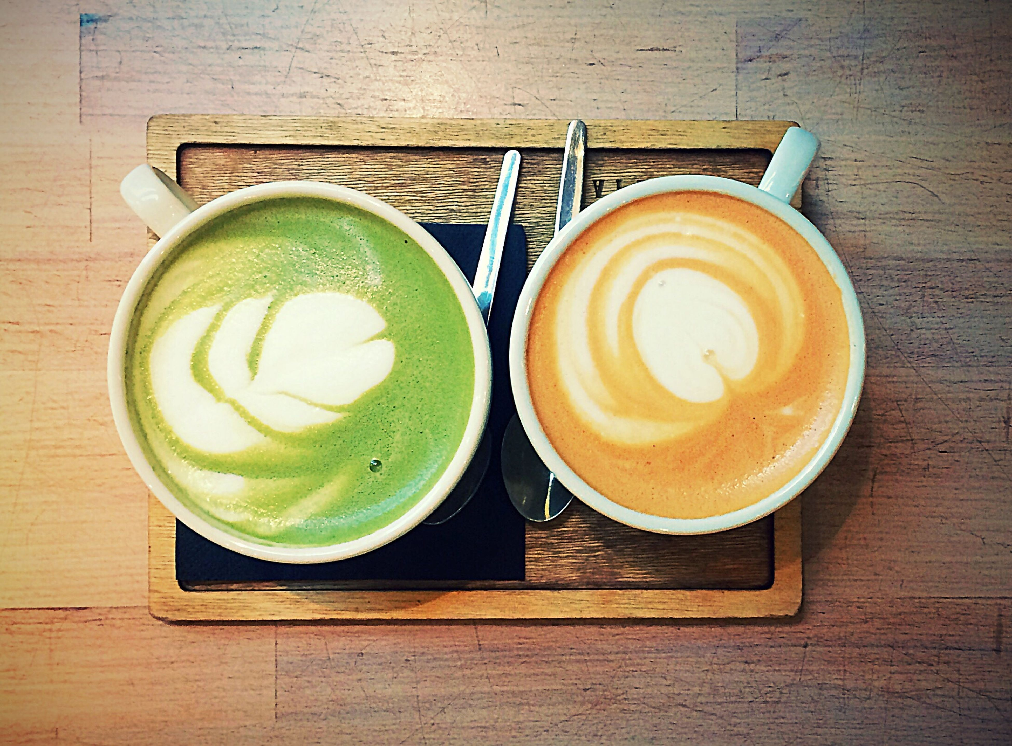 drink, cappuccino, coffee cup, coffee - drink, food and drink, frothy drink, refreshment, table, green color, freshness, directly above, espresso, indoors, froth art, latte, no people, drinking glass, healthy eating, close-up, day