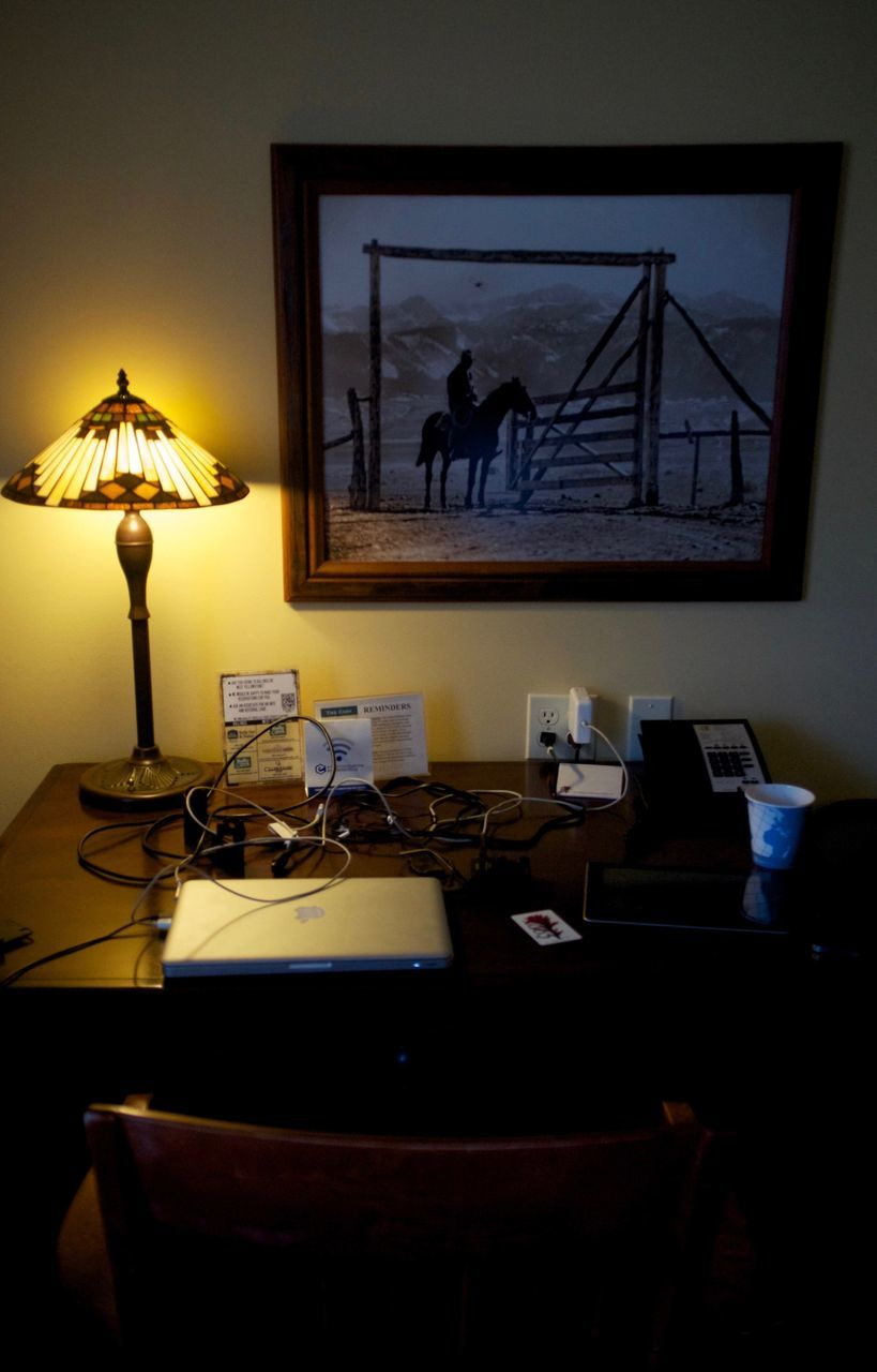 High Angle View Of Laptop And Illuminated Lamp On Table