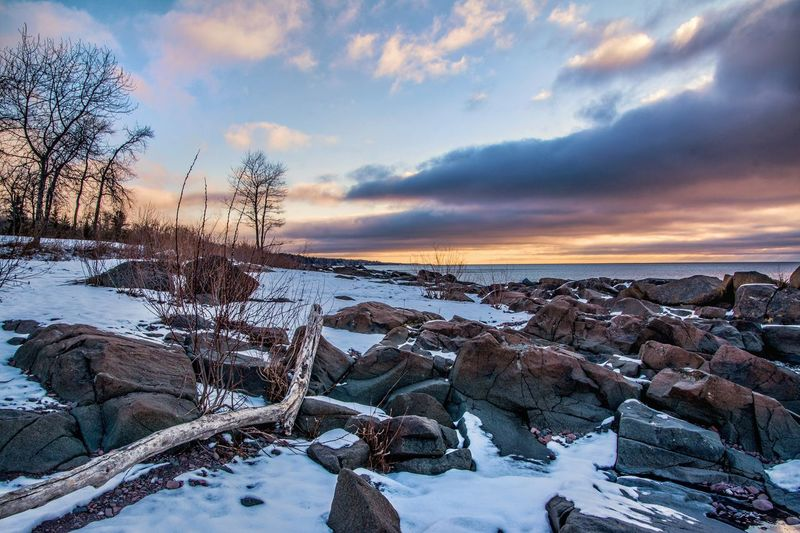Winter beach in Duluth, MN Cold Temperature Winter Snow Sky Beauty In Nature Nature Frozen Scenics Weather Cloud - Sky Tranquil Scene Tranquility Sunset Ice No People Outdoors Bare Tree Landscape Tree Water Malephotographerofthemonth Winter Lake Superior Streamzoofamily Sunrise