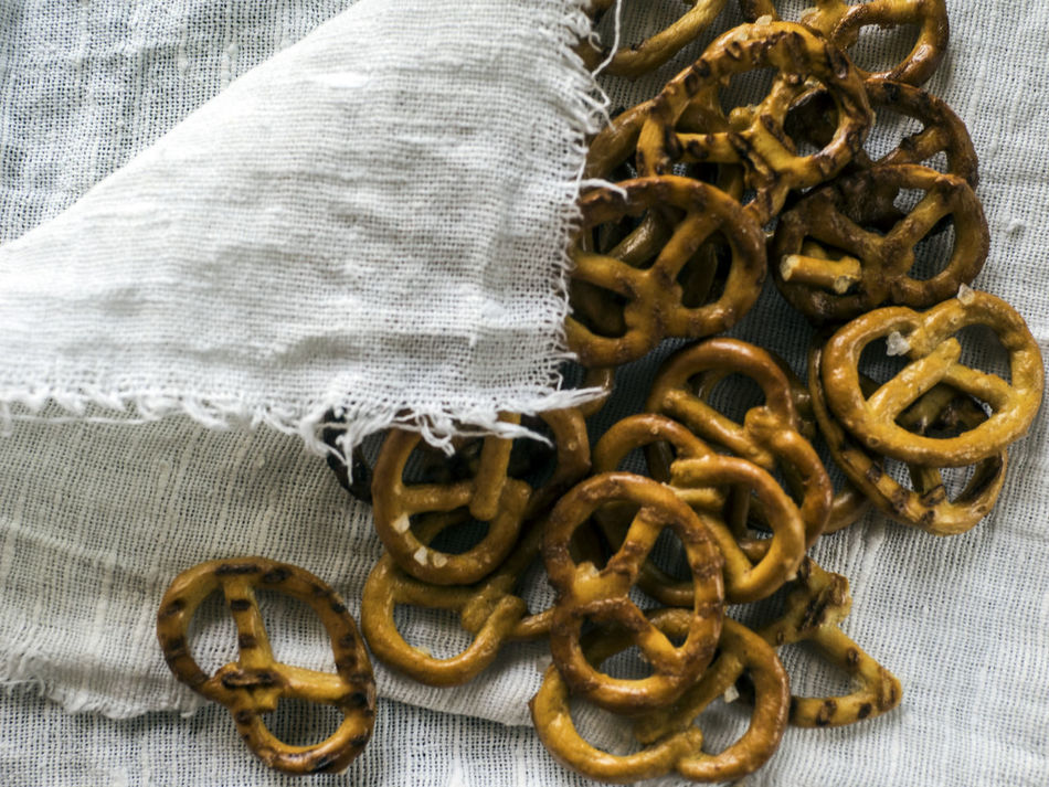 Heap of fresh Wheat salt pretzels on hessian linen fabric cloth and wooden table Abundance Close-up Cloth Collection Fabric Fresh Full Frame Group Of Objects Heap Hessian Indoors  Large Group Of Objects Linen Medium Group Of Objects Pretzels Salt Table Textile The Past Wheat Wooden Yellow