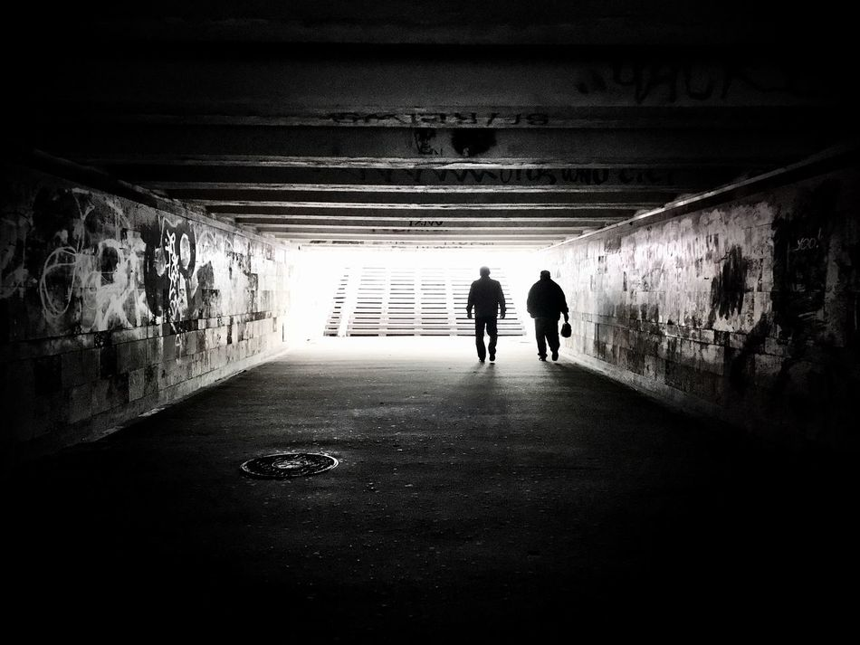 Real People Lifestyles Rear View The Way Forward Men Walking Tunnel Two People Full Length Built Structure Leisure Activity Indoors  Light At The End Of The Tunnel Day Architecture Women Togetherness Tunnel Vision Underground Passage Blackandwhite Kiev Ukraine Underground Shotoniphone7 Streetphotography Welcome To Black Welcome To Black