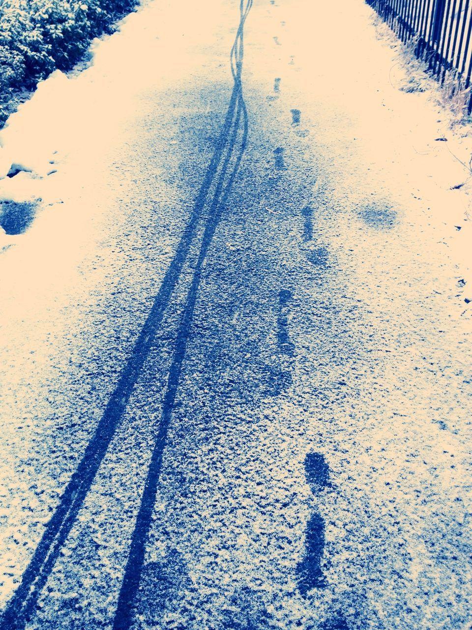 Close-up of empty snowed road