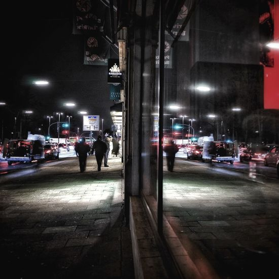 Reflection Night Illuminated Transportation Real People Architecture Land Vehicle Street Built Structure Building Exterior Car Mode Of Transport People One Person City Outdoors Men