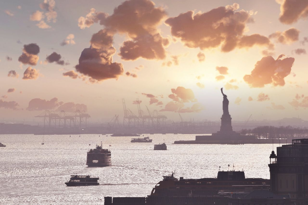 Travel Destinations Sky Statue Statue Of Liberty Sunset Cloud - Sky Sea Water Freedom Travel No People Patriotism Outdoors Urban Skyline NYC Photography NYC Silhouette Silhouettes River Silhouette_collection Silhouette Photography