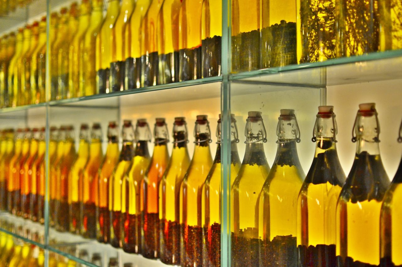 Beautiful stock photos of oil, Bottle, Food And Drink, In A Row, Indoors