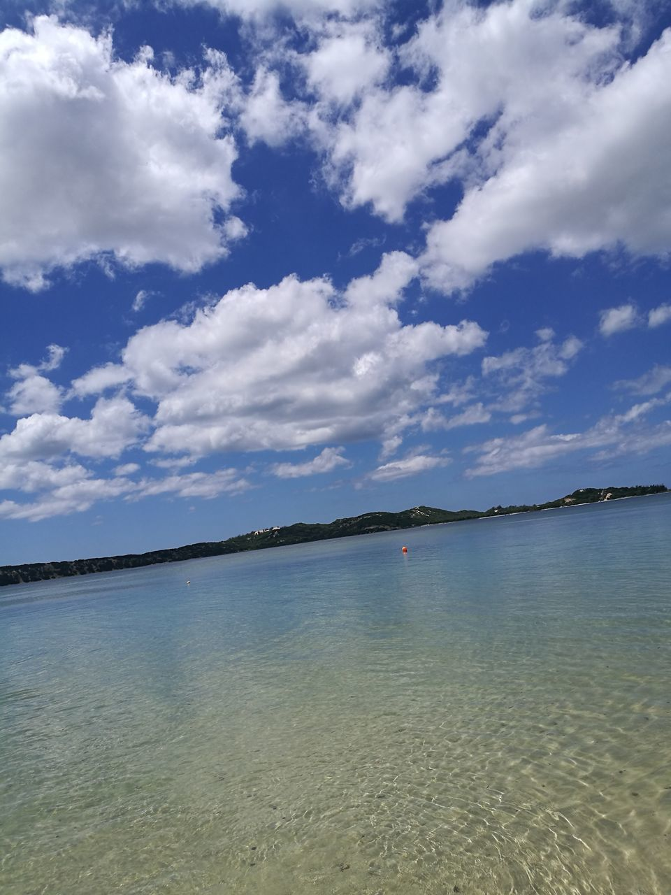 sky, tranquility, cloud - sky, scenics, tranquil scene, water, beauty in nature, nature, sea, outdoors, day, no people, beach