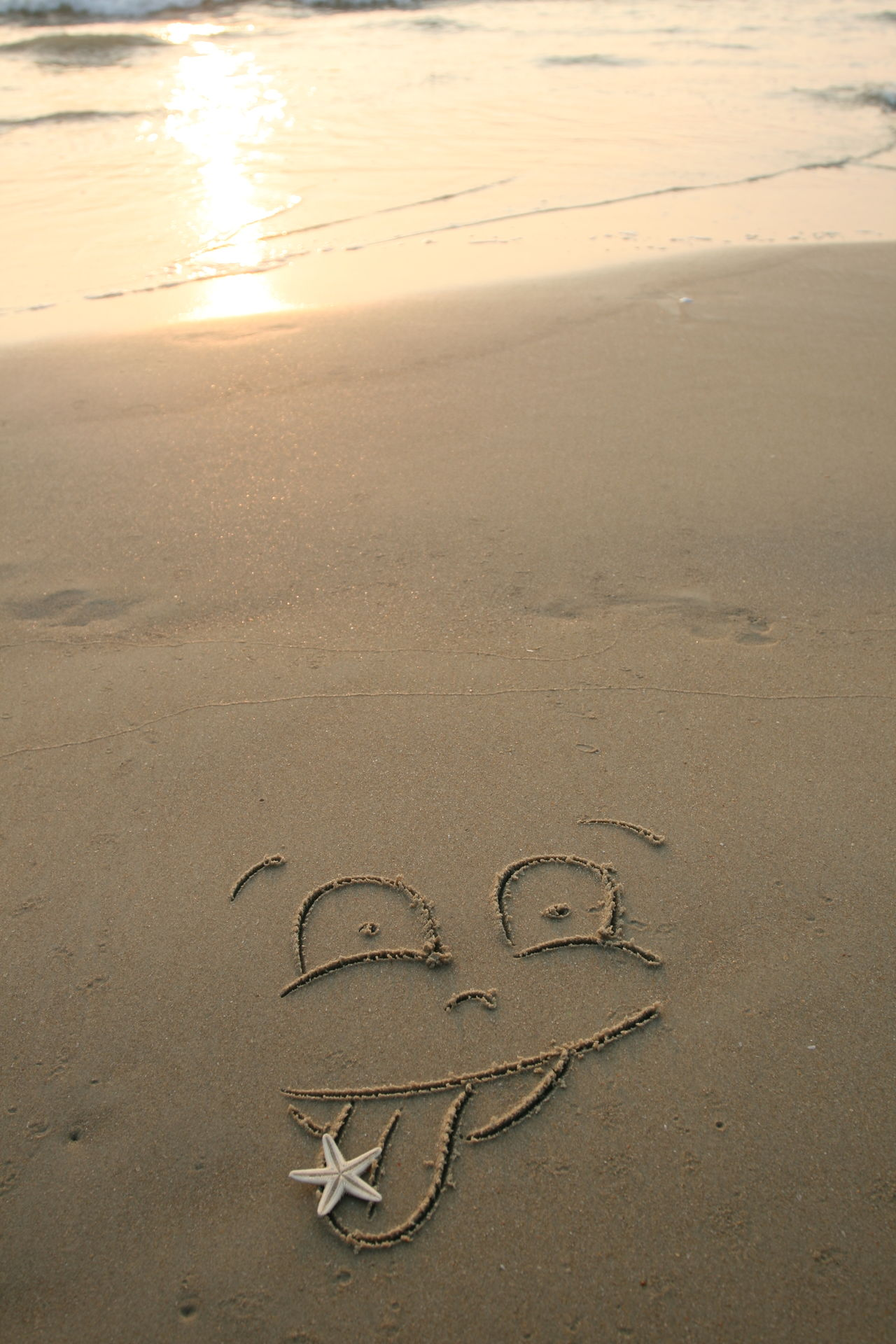Handwrited face on the sand at the beach Beach Beauty In Nature Day Drawing - Activity Drawing - Art Product Drawn Heart Shape Love Nature No People Outdoors Sand Sea Sunset