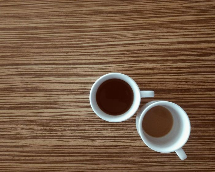 Cups Drink Coffee - Drink Refreshment Coffee Cup Food And Drink Tea Cup Table Directly Above Freshness High Angle View Tea - Hot Drink Wood - Material Indoors  Table Top Table Top Coffee Break Studio Shot No People Close-up White Cup Wood Background Beverage Hot Coffee Black Coffee