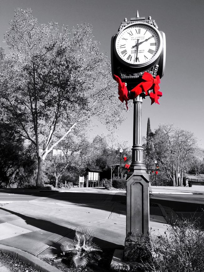 """Red Bows At Christmas Time"" Bright red Christmas bows adorn the Clayton Town clock and adjacent area in the small town of Clayton, California, USA. Red Bows Clock Tower Christmastime Christmas Decorations Small Town Bows Clock California Holidays"
