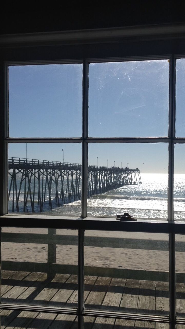 sea, window, water, sky, beach, day, no people, sunlight, horizon over water, scenics, built structure, indoors, architecture, nature