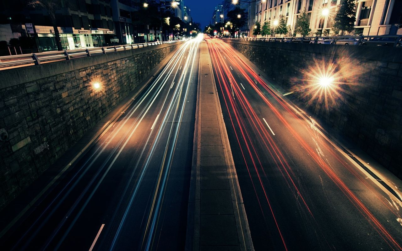 High Angle View Of Light Trails On Two Lane Highway At Night