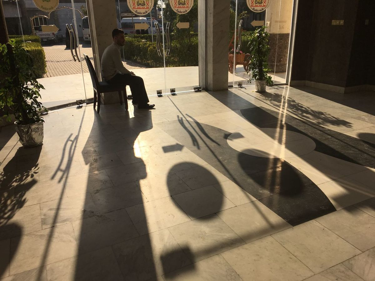 Guardian of the shadows Backlight Day Begins Doorway Guard Man Seated Morning Light Sentinel Shadows Silhouette